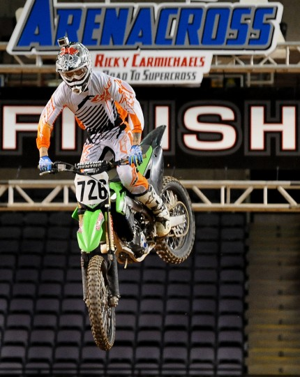 Gared Steinke completes the high jump by the finish line during early morning practice at the 1st Mariner Arena. The Arenacross event sets up at the arena in January. (Gene Sweeney Jr./Baltimore Sun)