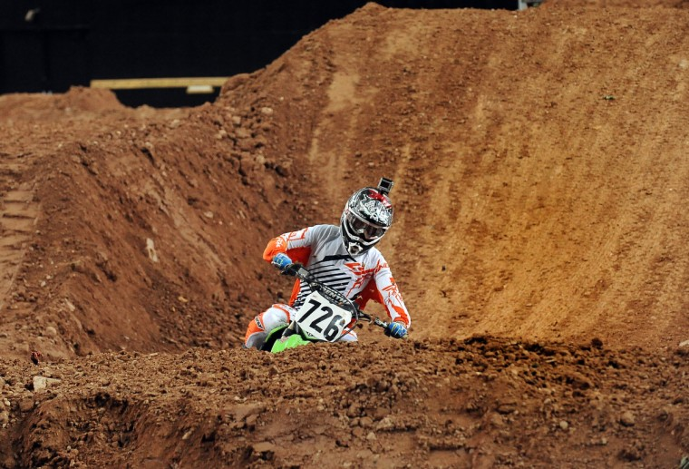Gared Steinke navigates the valley on the Arenacross track set up at the 1st Mariner Arena. (Gene Sweeney Jr./Baltimore Sun)