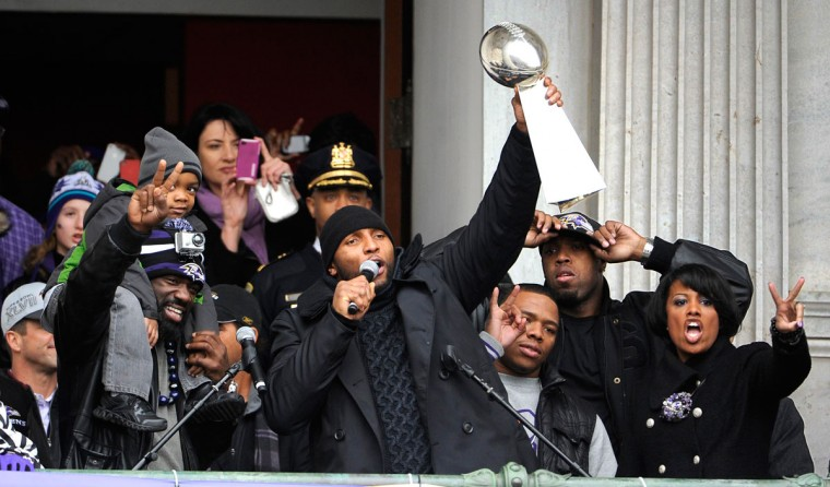 Ray Lewis lifts the Vince Lombardi Trophy while addressing the fans at City Hall during the Ravens Super Bowl victory celebration. (Barbara Haddock Taylor/Baltimore Sun Photo)