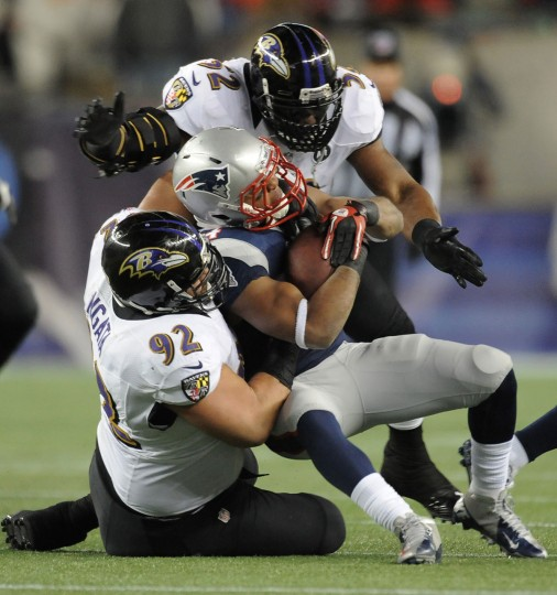 Ray Lewis (top) and Haloti Ngata (92) stop the New England Patriots' Shane Vereen during the Ravens' 28-13 win in the AFC championship game. (Gene Sweeney Jr./Baltimore Sun Photo)