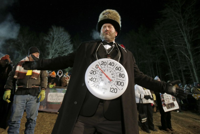 Jason Grusky, also known as The Big Chill and a member of the Inner Circle of the Groundhog Club, wears a thermometer showing the current low temperatures on the 127th Groundhog Day in Punxsutawney, Pennsylvania, February 2, 2013, as crowds wait for the weather-prognosticating groundhog Punxsutawney Phil on Gobbler's Knob. (Jason Cohn/REUTERS)