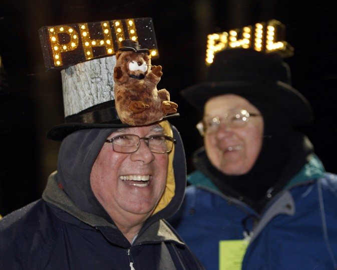 Fred Ungar (left) of York, Pennsylvania and Barry Edwards of Lancaster, Pennsylvania joke around while waiting for the weather-prognosticating groundhog, Punxsutawney Phil, to make his annual prediction on Gobbler's Knob in Punxsutawney, Pennsylvania, on the 127th Groundhog Day February 2, 2013. (Jason Cohn/Reuters)