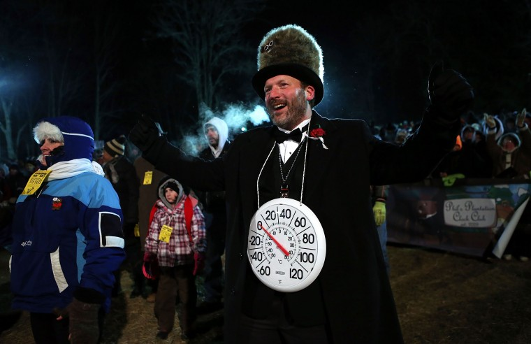 Big Chill' Jason Grusky, a member of the Punxsutawney 'Inner Circle,' gestures during the 127th Groundhog Day Celebration at Gobbler's Knob on February 2, 2013 in Punxsutawney, Pennsylvania. Thousands of people gathered at the event to watch Punxsutawney Phil's annual forecast.  (Photo by Alex Wong/Getty Images)