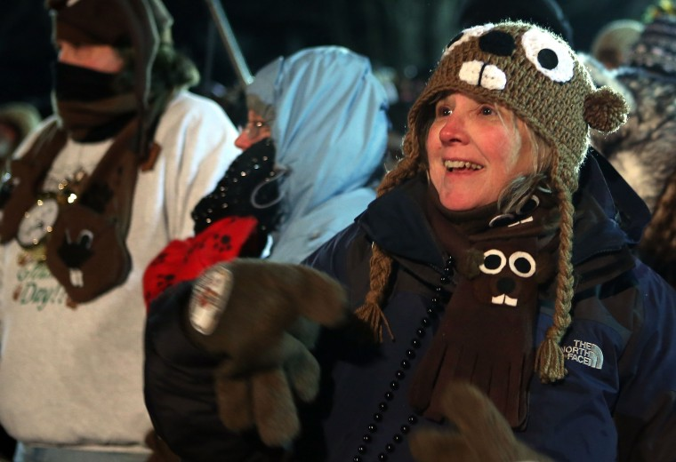 Pam Markin of Dallas, Texas, waits for Punxsutawney Phil to come out from his winter den during the 127th Groundhog Day Celebration at Gobbler's Knob on February 2, 2013 in Punxsutawney, Pennsylvania. Thousands of people gathered at the event to watch Punxsutawney Phil's annual forecast.  (Photo by Alex Wong/Getty Images)