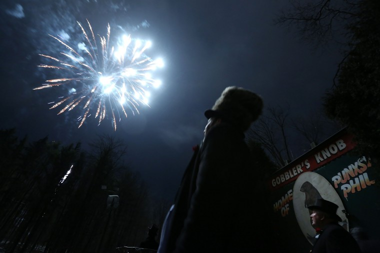 Fireworks are seen during the 127th Groundhog Day Celebration at Gobbler's Knob on February 2, 2013 in Punxsutawney, Pennsylvania. The Punxsutawney 'Inner Circle' claimed that there were about 35,000 people gathered at the event to watch Phil's annual forecast.  (Photo by Alex Wong/Getty Images)