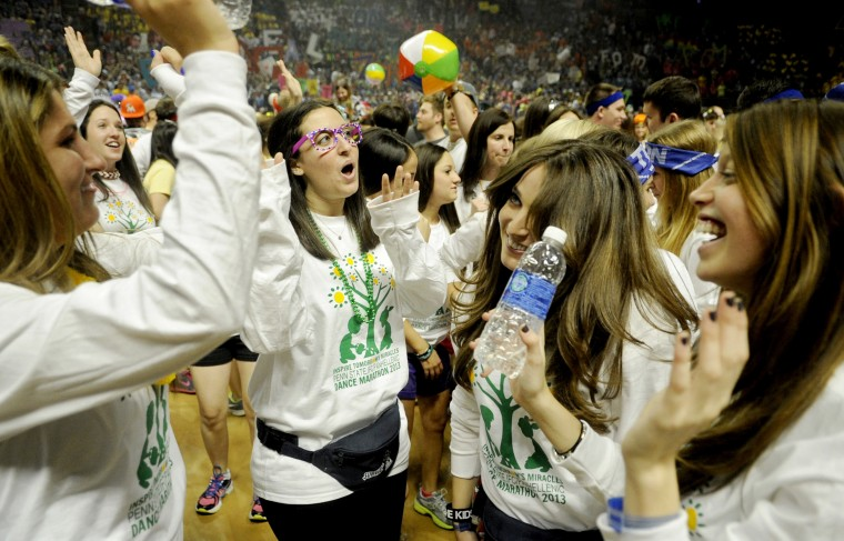 Alexa Cutler, Keren Salomon, Ben Zeer, Maddy Meislin, and Shelby Rudolph celebrate the start of the Penn State IFC/Panhellenic Dance Marathon on Friday, February 15, 2013, in University Park, Pennsylvania. Dancers started Friday and will continue for 46 hours. The event, known as Thon, raises money to help families that are battling pediatric cancer. Last year's event raised $10 million. (Abby Drey/Centre Daily Times/MCT)