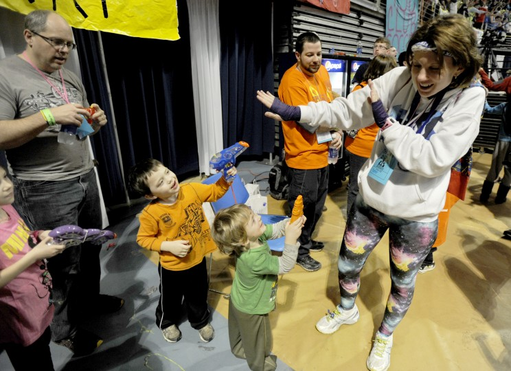Jodie Potter is greeted by squirt guns from her children Manna, Jay, and Corban, after arriving at the Bryce Jordan Center for the Penn State IFC/Panhellenic Dance Marathon on Friday, February 15, 2013, in University Park, Pennsylvania. Potter came as part of was a group of 24 runners that completed a 135-mile journey from the pediatrics floor at Hershey Medical Center. The event raises money to help families that are battling pediatric cancer, including the Potters. (Abby Drey/Centre Daily Times/MCT)