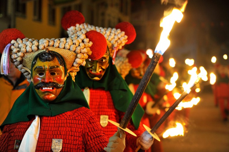 Carnival enthusiasts dance in the streets of Elzach in a costume of the so-called 'Schuttig' during the traditional torch parade on January 12, 2013 in Elzach, Germany. The Elzach procession launches the carnival season in southwestern Germany which culminates on Rose Monday. Dating from 1530 the carnival marks a festive period where the bad spirits are expelled prior to the Lenting season. (Harold Cunningham/Getty Images)