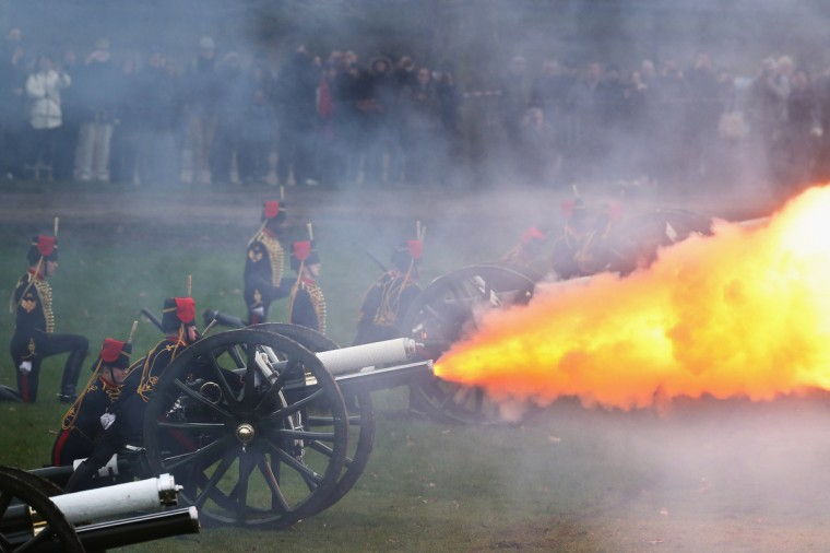 The King's Troop, Royal Horse Artillery fire a 41-gun salute in Green Park in London, England. The salute was to mark the 61st anniversary of the Queen's accession to the throne. (Dan Kitwood/Getty Images)