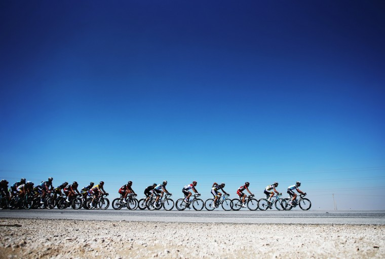 The peloton makes its' way through the Qatar desert on stage four of the Tour of Qatar from Camel Race Track to Al Khor Cornichenear Camel Race Track, Qatar. (Bryn Lennon/Getty Images)