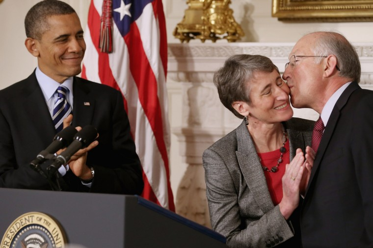 REI Chief Executive Officer Sally Jewell (C) is congratulated by outgoing Interior Secretary Ken Salazar after she was nominated by President Barack Obama to be the next Secretary of the Interior in the State Dining Room of the White House in Washington, DC. Jewell has been CEO of the huge outdoor retailer REI since 2005. (Chip Somodevilla/Getty Images)