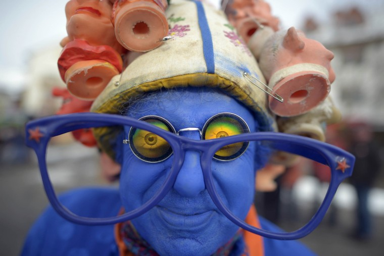 A carnival reveler wears fancy dress and blue face-paint during the Springerzug carnival parade on the annual Rose Monday (Rosenmontag) in Herbstein, Germany. (Thomas Lohnes/Getty Images)