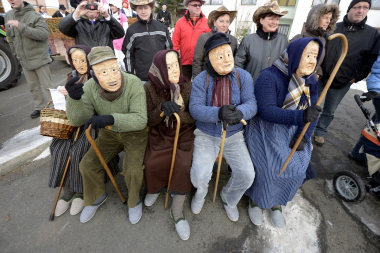 Carnival revelers wear elderly face-masks as they participate in the annual Rose Monday at the Herbsteiner Springerzug on February 11, 2013 in Herbstein, Germany. (Thomas Lohnes/Getty Images)