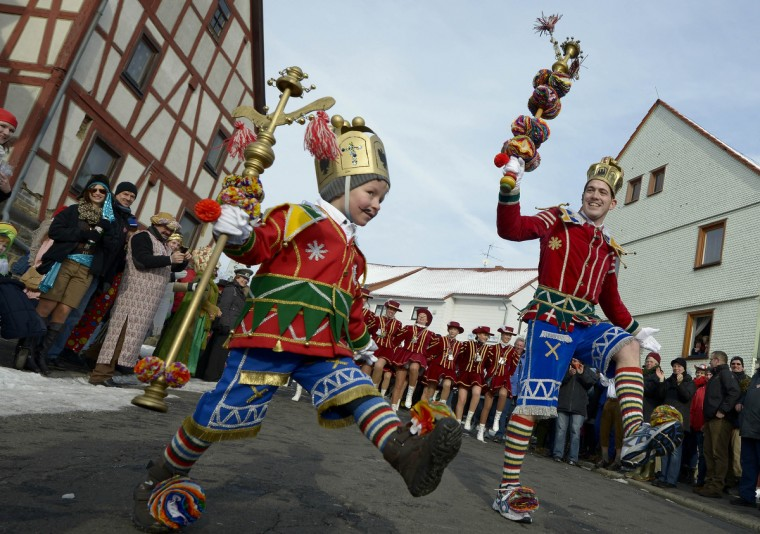"The carnival figure ""Bajazz"" (R) leads the Herbsteiner Springerzug on February 11, 2013 in Herbstein, Germany. The Springerzug, literally ""jumping parade"", is an interpretation of carnival tradition particular to Herbstein. Niklas (l.) attend the Springerzug. (Thomas Lohnes/Getty Images)"