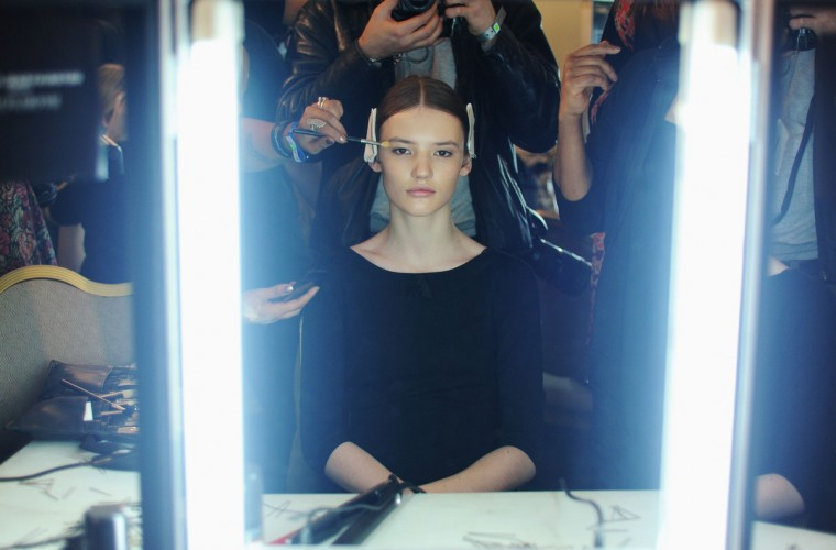 A model has her make up applied backstage at the Roksanda Ilincic show during London Fashion Week Fall/Winter 2013/14 at The Savoy in London, England. (Stuart Wilson/Getty Images)