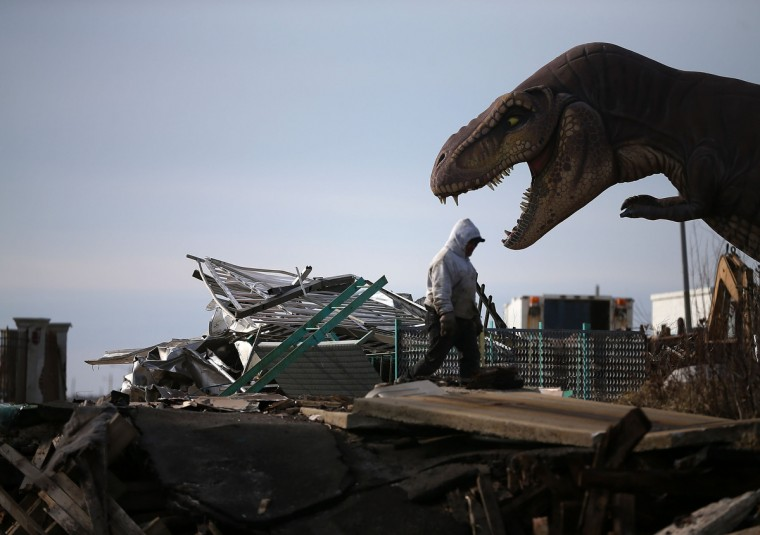 A worker cleans debris from the Fun Town Pier that was damaged by Superstorm Sandy in Seaside Heights, New Jersey. Governor Chris Christie has estimated that damage in New Jersey caused by Superstorm Sandy could reach $37 billion. New Jersey. (Mark Wilson/Getty Images)