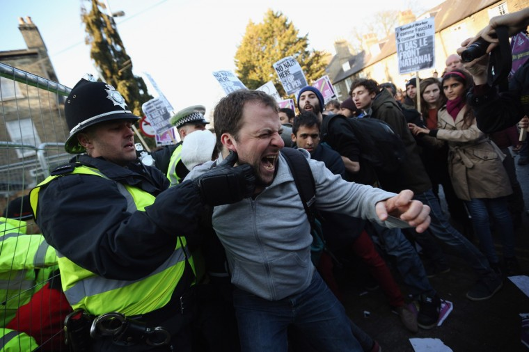 Protesters clash with police outside Cambridge University's Student Union as Marine Le Pen, the leader of the French far-right 'Front National' party, prepares to address the Union's debating society on in Cambridge, England. Mrs Le Pen, who has been an MEP since 2004 and is the daughter of former Front National leader Jean Marie Le Pen, is expected to speak about the future of the European Union and French politics. Although her appearance at the Union has provoked controversy with the anti-fascist group 'Unite Against Fascism'. (Oli Scarff/Getty Images)