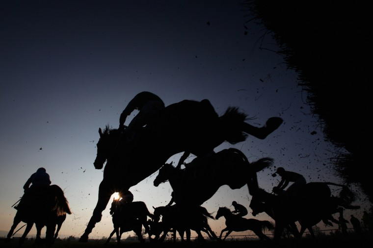 Horses clear a hurdle during 'The Family Fun Day Meeting 4th April Handicap Hurdle Race' at Taunton Racecourse in Taunton, England. (Harry Engels/Getty Images)