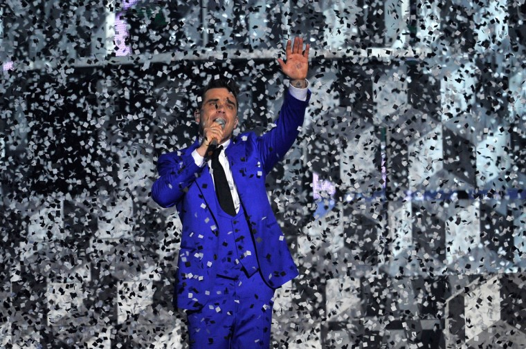 Robbie Williams performs on stage during the Brit Awards 2013 at the 02 Arena on February 20, 2013 in London, England. (Matt Kent/Getty Images)