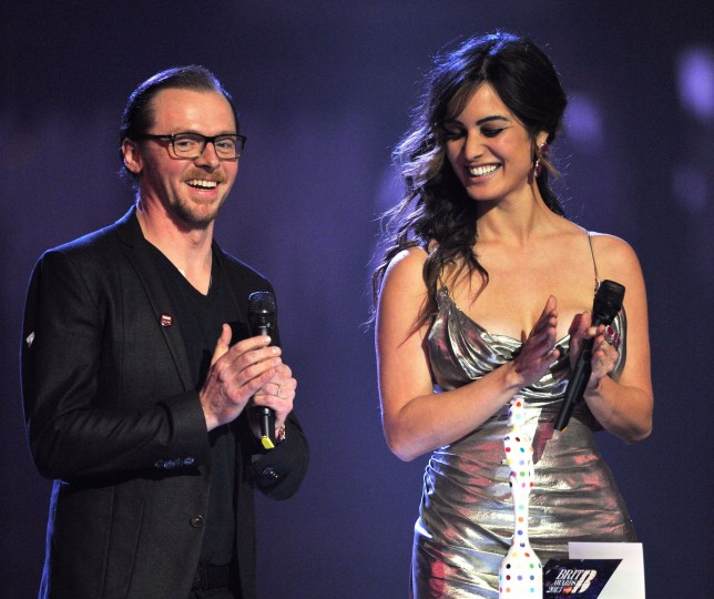 Simon Pegg and Berenice Marlohe present British Group on stage during the Brit Awards 2013 at the 02 Arena. (Matt Kent/Getty Images)