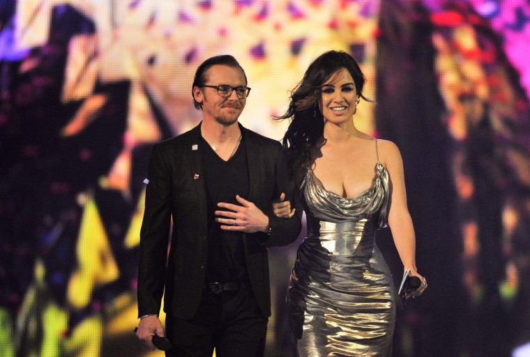 Simon Pegg and Berenice Marlohe arrive to present British Group on stage during the Brit Awards 2013 at the 02 Arena. (Matt Kent/Getty Images)