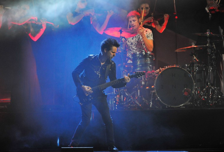 Matthew Bellamy of Muse performs on stage during the Brit Awards 2013 at the 02 Arena. (Matt Kent/Getty Images)