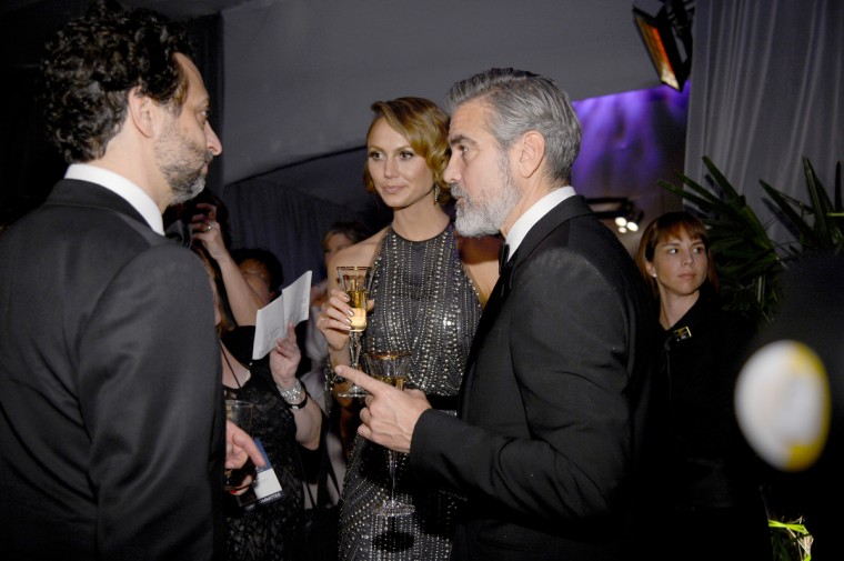 Producers George Clooney (R) and Grant Heslov (R), winners of the Best Picture award for 'Argo,' and Stacy Keibler (C) attend the Oscars Governors Ball at Hollywood & Highland Center on February 24, 2013 in Hollywood, California. (Kevork Djansezian/Getty Images)