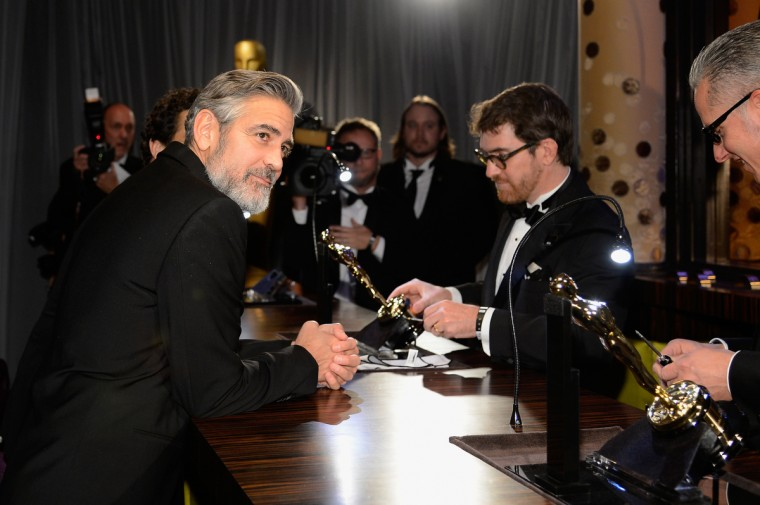 Producer George Clooney, winner of the Best Picture award for 'Argo,' gets his Oscar engraved at the Oscars Governors Ball at Hollywood & Highland Center on February 24, 2013 in Hollywood, California. (Kevork Djansezian/Getty Images)