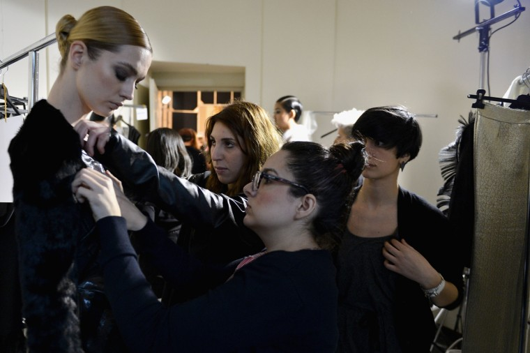 A model prepares backstage at the Cristiano Burani fashion show during Milan Fashion Week Womenswear Fall/Winter 2013/14 in Milan, Italy. (Tullio M. Puglia/Getty Images)