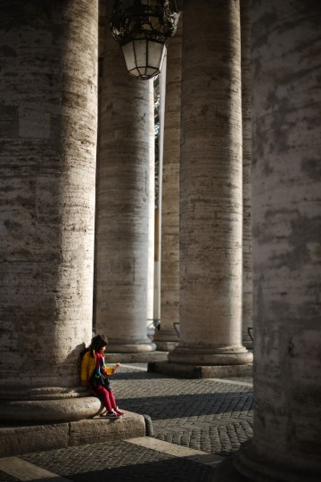 A child sits under The Colonnade in Vatican City, Vatican. The Pontiff will hold his last weekly public audience before he retires. Pope Benedict XVI has been the leader of the Catholic Church for eight years and is the first Pope to retire since 1415. He cites ailing health as his reason for retirement and will spend the rest of his life in solitude away from public engagements (Peter Macdiarmid/Getty Images)