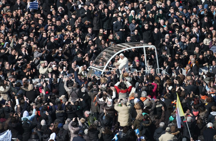 Pope Benedict XVI waves to the faithful from the Popemobile as he arrives in St Peter's Square in Vatican City, Vatican. The Pontiff has attended his last weekly public audience before stepping down tomorrow. Pope Benedict XVI has been the leader of the Catholic Church for eight years and is the first Pope to retire since 1415. He cites ailing health as his reason for retirement and will spend the rest of his life in solitude away from public engagements. (Peter Macdiarmid/Getty Images)