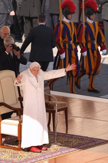 Pope Benedict XVI gestures to the crowd in St Peter's Square on February 27, 2013 in Vatican City, Vatican. The Pontiff has attended his last weekly public audience before stepping down tomorrow. (Oli Scarff/Getty Images)