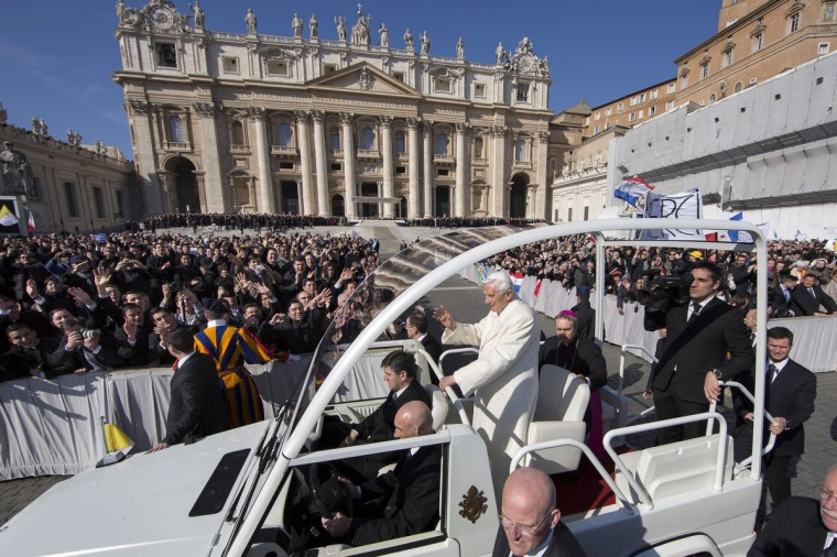 Pope Benedict XVI travels through the crowd in the popemobile in St Peter's Square on February 27, 2013 in Vatican City, Vatican. The Pontiff will hold his last weekly public audience later before he abdicates tomorrow. (Carsten Koall/Getty Images)