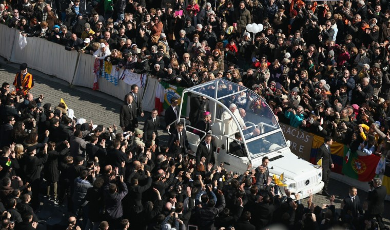 Pope Benedict XVI travels in the Popemobile through St Peter's Square on February 27, 2013 in Vatican City, Vatican. The Pontiff has attended his last weekly public audience before stepping down tomorrow. (Oli Scarff/Getty Images)