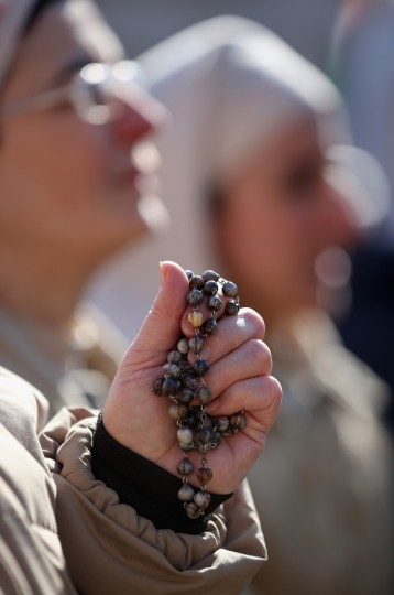 A nun holds her rosary beads as she attends Pope Benedict XVI's final general audience in St Peter's Square before his retirement on February 27, 2013 in Vatican City, Vatican. (Christopher Furlong/Getty Images)
