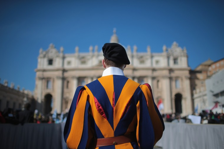 A Swiss guard stands in front of the Vatican as Pope Benedict XVI delivers his final general audience in St Peter's Square before his retirement on February 27, 2013 in Vatican City, Vatican. The Pontiff has held his last weekly public audience before stepping down tomorrow. (Christopher Furlong/Getty Images)
