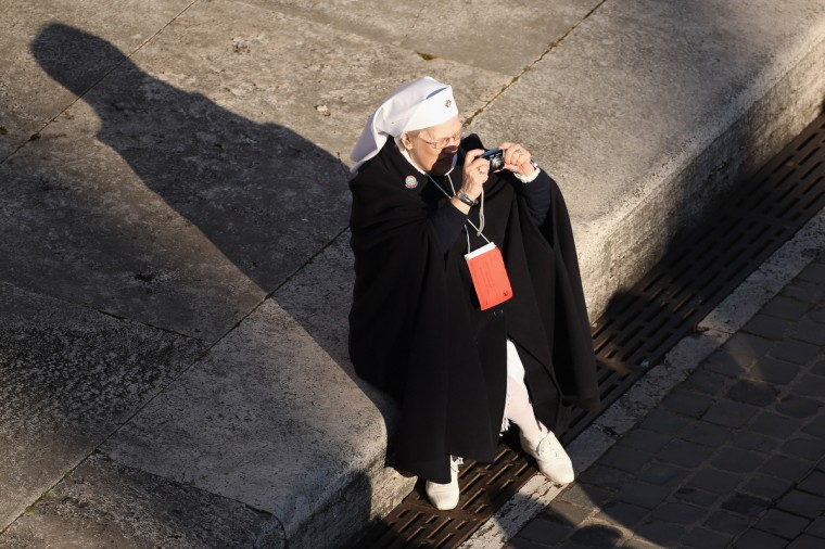 A nun takes a photograph in St Peter's Square before Pope Benedict XVI's final weekly public audience on February 27, 2013 in Vatican City, Vatican. The Pontiff has attended his last weekly public audience before stepping down tomorrow. Pope Benedict XVI has been the leader of the Catholic Church for eight years and is the first Pope to retire since 1415. (Oli Scarff/Getty Images)