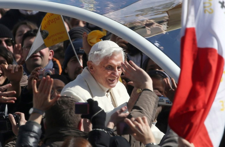 Pope Benedict XVI waves to the faithful as he arrives in St. Peter's Square for his final general audience on February 27, 2013 in Vatican City, Vatican. The Pontiff attended his last weekly public audience before stepping down tomorrow. (Franco Origlia/Getty Images)