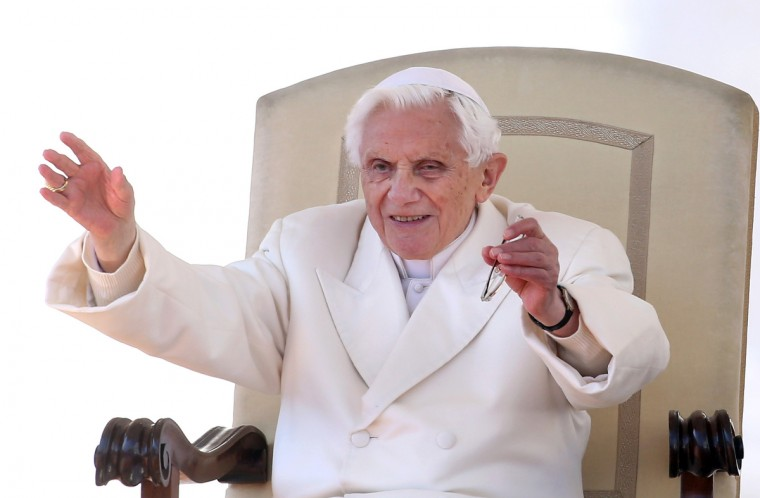 Pope Benedict XVI waves to the faithful gathered in St. Peter's Squareduring his final general audience on February 27, 2013 in Vatican City, Vatican. The Pontiff attended his last weekly public audience before stepping down tomorrow. (Franco Origlia/Getty Images)