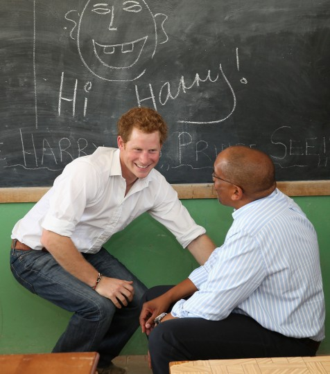Prince Harry learns sign language during at visit to the Kananelo Centre for the deaf, a project supported by his charity Sentebale on in Maseru, Lesotho. Sentebale is a charity founded by Prince Harry and Prince Seeiso of Lesotho. It helps the most vulnerable children in Lesotho get the support they need to lead healthy and productive lives. Sentebale works with local grassroots organizations to help these children, the victims of extreme poverty and Lesotho's HIV/AIDS epidemic. Cathy Ferrier was appointed as Sentebale's Chief Executive in March 2012 and is spearheading a fundraising initiative to build the Mamohato Centre which will provide psychosocial support for children and young people infected with HIV. Prince Harry is due to pay a visit to Lesotho this week to catch up on his charity's progress and meet key children who will be supported by the charity. (Chris Jackson/Getty Images)