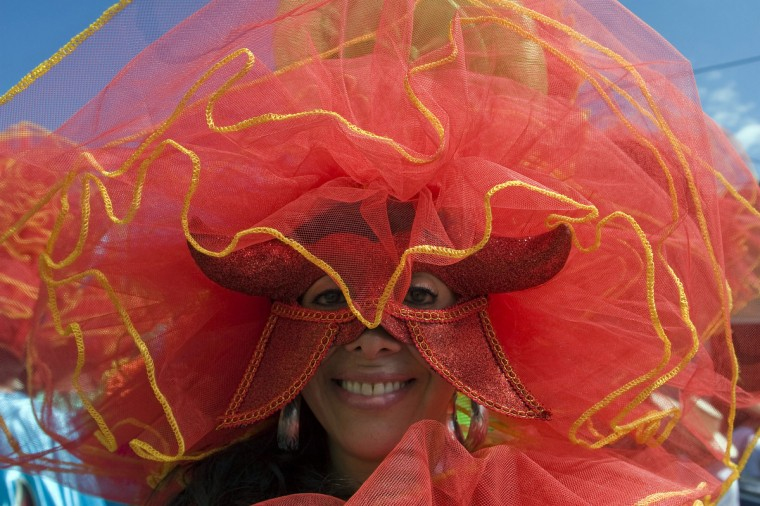 A reveler takes part in the Devil's Carnival in Riosucio, Caldas department, Colombia, on January 6, 2013. Riosucio's Carnival was proclaimed by UNESCO as a cultural intangible heritage and takes place every two years. (Fredy Amariles/Getty Images)
