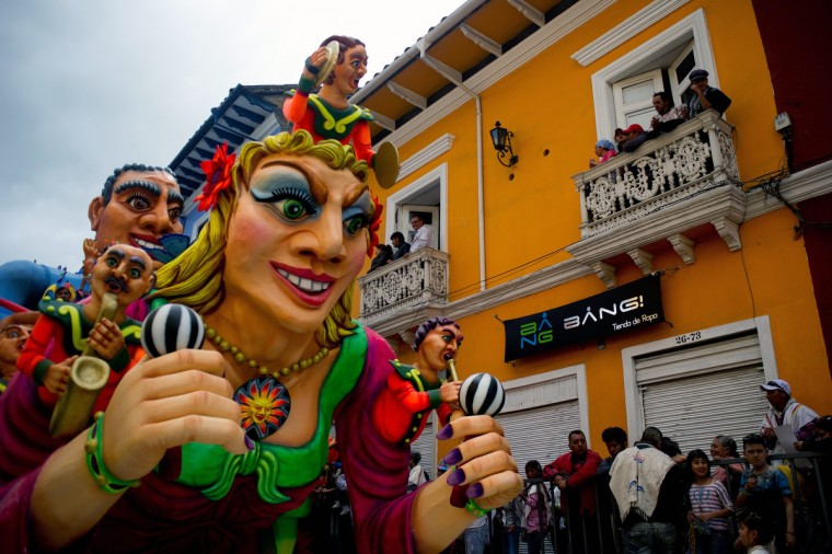 "People look at a float during the ""White Day"" parade, part of the Carnival of Blacks and Whites in Pasto, Colombia, on January, 6, 2013. The Carnival of Blacks and Whites was declared by UNESCO as ""Intangible Cultural Heritage of Humanity"", and is celebrated every year on the eve of the ""Three Kings Day"". (Luis Robayo/Getty Images)"