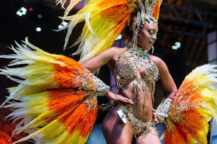 The new first Princess of Sao Paulo's Carnival, Kimberlyn Muriel Adabe Santos, dances during the competition for new King, Queen and Princess of the Carnival parade in Sao Paulo, Brazil, late on January 17, 2013. Sao Paulo's carnival is scheduled for February 8 and 9. (Yasuyoshi Chiba/Getty Images)