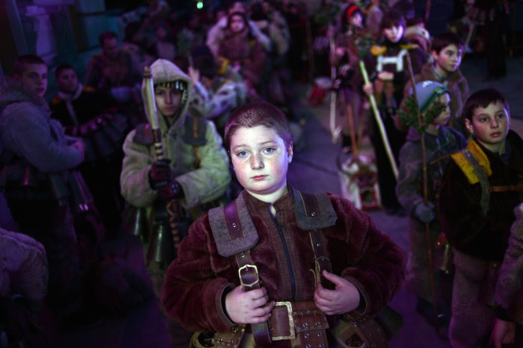 A boy attends the opening ceremony of the International Festival of the Masquerade Games in Pernik near the capital Sofia, on February 1, 2013. The three-day festival, which started on January 28, has participants sporting multi-colored masks, covered with beads, ribbons and woolen tassels whlie the main dancer, ladened with bells to drive away sickness and evil spirits, sways like a wheat spikelet heavy with grain. (Dimitar Dilkoff/Getty Images)