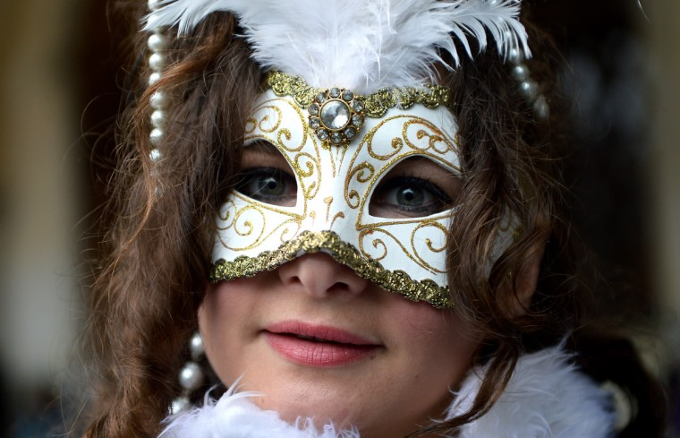 "A costumed reveller poses at St Mark's square during the carnival on February 2, 2013 in Venice. The 2013 edition of the Venice carnival is untitled "" Live in Colour"" and runs from January 26 to February 12. (Vincenzo Pinto/Getty Images)"
