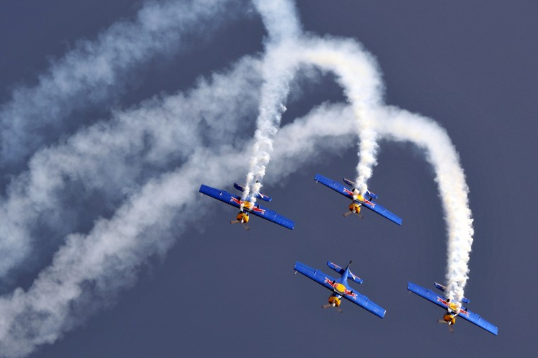 Members of The Flying Bulls aerobatics team from the Czech Republic fly in formation in their Zlin Z-50 aircraft during Aero India 2013 at the Yelahanka Air Force station in Bangalore. India, the world's leading importer of weaponry, opened one of Asia's biggest aviation trade shows Wednesday with Western suppliers eyeing lucrative deals and a Chinese delegation attending for the first time. (Manjunath Kiran/Getty Images)