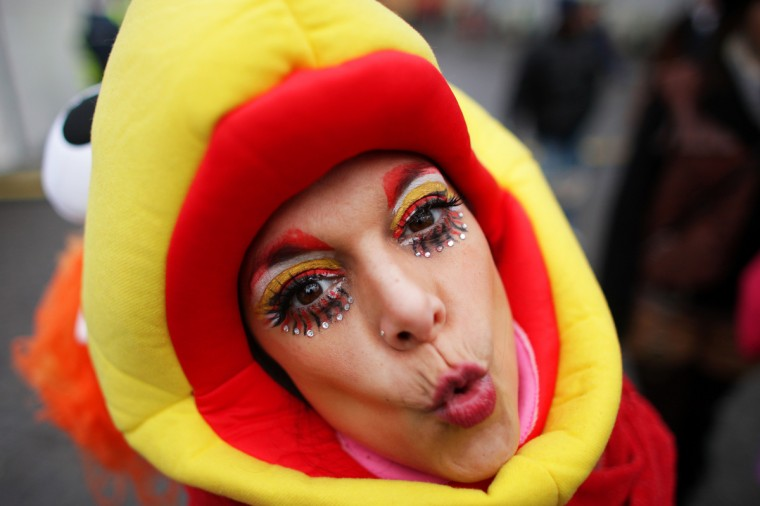 A fool celebrates the beginning of the street carnival in Cologne, western Germany on February 7, 2013, as the hot carnival season was launched. Hundreds of thousands of Germans, mainly in the western Rhine region, crowd the streets to celebrate Women's Carnival Day. (Rolf Vennenbernd/Reuters)