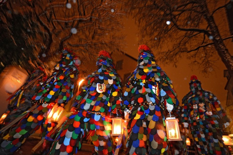 "A group of the Constance fool's guild ""Blätzlebueben"" is pictured with lanterns in Constance, southern Germany, on February 7 , 2013. Since the early morning, hundreds of dressed up people walk through the city to wake the population. (Felix Kaestle/Getty Images)"