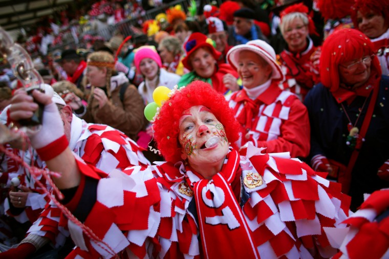 Fools celebrate the beginning of the street carnival in Cologne, western Germany on February 7, 2013, as the hot carnival season was launched. Hundreds of thousands of Germans, mainly in the western Rhine region, crowd the streets to celebrate Women's Carnival Day. (Rolf Vennenbernd/Reuters)