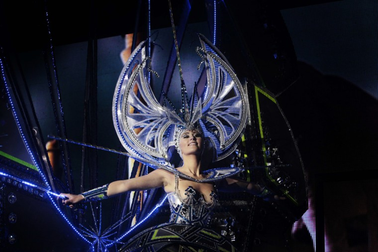A nominee for Queen of the 2013 Santa Cruz carnival performs in Santa Cruz de Tenerife on the Spanish Canary island of Tenerife on February 6, 2013. (Desiree Martin/Getty Images)